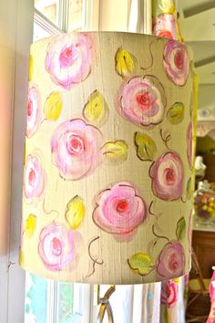 A floral hand painted lamp shade in my home made to match the gold curtains in the living room. I use acrylic mixed with fabric medium and loosely sketch what I'm about to paint with pencil first.