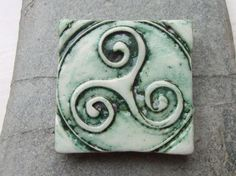 Handmade Green Ceramic Pottery Triskele Magnet - kitchen office decoration This piece has now been sold but similar pieces can be made to order via my Etsy store. https://www.etsy.com/uk/transaction/170449487?