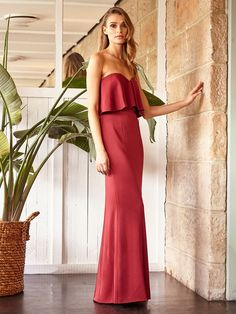 If you're looking to make a bold statement at your next Spring Carnival event, look no further than our floor-scraping Gloria Maxi! Designed for a figure hugging silhouette, this elegant evening gown is made for show-stopping moments.