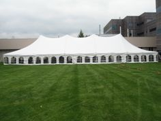 Perfect for a large party in any weather! 40 x 100 high peak pole tent with french window sidewalls. 844-TENT PRO