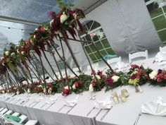 40 ft. table garland with mile-high arrangement for the head table! Photo Credit: Tom Maurina