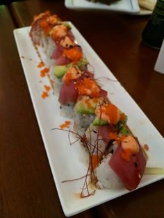 Double Tuna - Spicy tuna wrapped with fresh tuna and avocado topped with onion and spicy sauce @ The Room sushi, Westwood