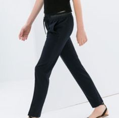 Pants with leather strap