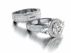 """This stylish band features two rows of channel set princess cut diamonds and two rows of pave set round brilliant cut diamonds with milgrain edges. Literally, milgrain translates to """"a thousand grains"""", and is a row of tiny beads along the edge or boundary of a section of jewelry. This band was designed to accompany the platinum engagement ring in the photos on this page. #imagesjewelers #customjewelry #engagementring #weddingring #diamondring #diamonds #jewelrydesign"""