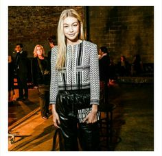 Palestinian model Gigi Hadid in a jacket inspired by the Palestinian keffiyeh.