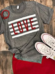 It's the season of LOVE! This red glitter love graphic tee has to be one of our favorite tees for the season. This tee is a unisex fit. Material: Cotton, Polyester Fit: True to size. Care: Hand wash inside out for best results. Valentine Shirts, Love Valentines, Monogram Shirts, Vinyl Shirts, Monogram Letters, Love Shirt, Diy Shirt, Vinyl Designs, Shirt Designs