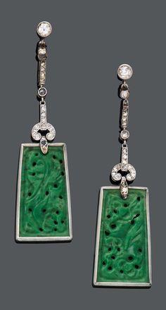 A PAIR OF JADEITE JADE AND DIAMOND EAR PENDANTS, CIRCA 1920. Each suspending a carved jadeite jade with a diamond surround. Length 5.8cm. #ArtDeco #earrings