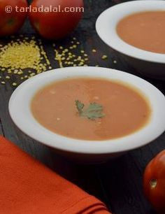 Who doesn't love the tangy, appetizing flavour and creamy mouth-feel of Tomato Soup? Here is a variant with a desi touch, where the tomatoes are blended with cooked moong dal, to improve the texture and balance the flavour too.