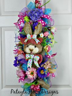 A personal favorite from my Etsy shop https://www.etsy.com/listing/266730060/easter-bunny-swag-easter-rabbit-swag