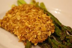 This recipe is from the back of the Kelloggs box . It is different than other baked chicken because it is dipped in batter and then rolled in cornflake crumbs producing an extremely crunchy chicken.