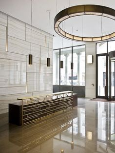 Circular feature lighting for reception are. LSE Lighting  Such a beautiful, natural looking colour.