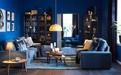 Blue living room with glass-fronted cabinets and two blue sofas, one with chaise lounges. **this is how it should be****
