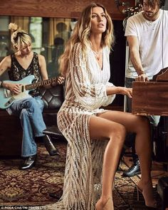 Tickling the ivories: This sheer bohemian gown was worn for this shot as she played the piano