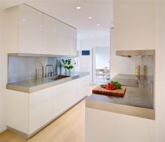 I like the idea of matching the backsplash, counter and lip to hide lighting.