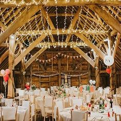 The gorgeous barn needed little decoration but it was enhanced with magical fairy lights, bunting, balloons and a paper heart backdrop ✨ Link in profile. Image @ireneyap
