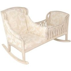 A Heirloom Piece! Rock and soothe your little one to sleep in elegance and style with this beautiful Patricia Cradle Rocker. This unique heirloom piece combines a comfy upholstered rocker and a stunning padded cradle in one!