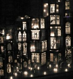Mathilde Nivet paper-cut buildings with lighting, trees, balconies, and other decorative details. #paper #art