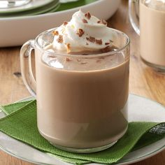 Mocha Eggnog Recipe -This chocolaty twist on traditional eggnog will spread good cheer at your Christmas or New Year's celebration. My family makes a batch each year to sip while opening presents. —Beth Ann Hill, Dayton, Ohio