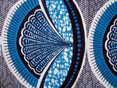 African wax print fabric. ...this and others on site are beautiful all kinds of colours and patterns..