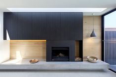 Photo 262 of 740 in Best Living Wood Burning Photos from A Streamlined Addition Serves a Family of Four in Australia - Dwell Concrete Fireplace, Fireplace Hearth, Fireplace Design, Concrete Floors, Fireplaces, Fireplace Feature Wall, Fireplace Stores, Wood Store, Oak Panels