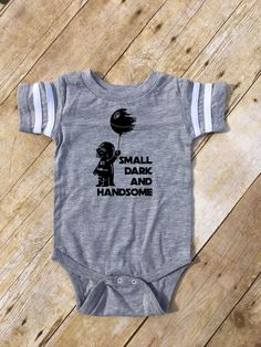 Small Dark and Handsome. Darth Vader one-piece. Death Star one-piece. Football style one-piece. Nerdy baby gift. Geek baby gift. I use only high quality apparel, high quality heat transfer vinyl and a heat press to ensure longevity. Clothing brand: LAT Apparel: Runs true to size Vinyl colors: White, Black, Gold, Silver, Copper, Orange Glitter Vinyl: Gold, Silver, Black, White, Aqua, Orchid, Green Metallic Vinyl: Red, Purple, Blue, Yellow Please specify the vinyl color you would like in the…