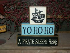 Boys Pirate Ship Primitive Wood Sign Blocks Birthday Parties Centerpiece Personalized Distressed Stacking Blocks Pirate Ship. $22.99, via Etsy.