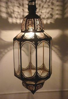 Moroccan clear glass chandelier in an octagonal shape. [$490.00]