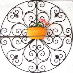 A beautiful wrought iron wall hanging with a frame for a flower pot from My Sunny Balcony, Bangalore