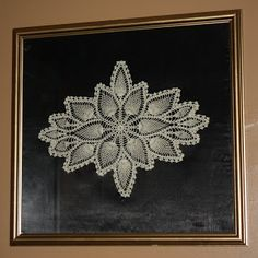 Doily Wall Art   This is kind of a blast from the past.  Start out by starching and stretching a doily with pins     While the doily is dryi...