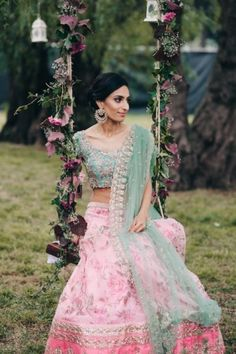 Floral print lehenga- bride sitting on swing