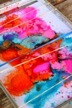 Erupting rubber band snap painting - A painting activity that snaps, splatters, and fizzes!