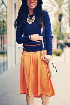 blue knit, orange skirt