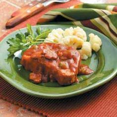 """Tender Pork Chops Recipe -""""Not only is it easy to use my slow cooker, but the results are fabulous,"""" notes Bonnie Marlow of Ottoville, Ohio. """"Meat cooked this way is always so tender and juicy. These pork chops in a thick tomato sauce turn out great."""""""