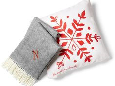 Snuggle up to gifts that will warm their hearts. And their toes. Custom pillows and monogrammed blankets make the perfect present.