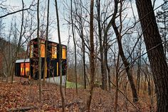 "Chicago magazine says: ""MODEST MODERN: An ingeniously minimalist house redefines ""cabin"" on a wooded hillside in Wisconsin."""