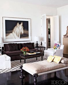 In the living room, the sofa is upholstered in a Larsen velvet, the antique Chinese cocktail table is from JF Chen, and the photograph is by Michael Eastman.