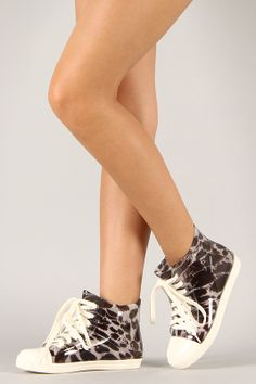 Splash the sidewalk with this cute jelly sneaker! Featuring leopard print jelly upper, contrast color round toe cap, lace up design, cushioned insole, and easy slip on style.