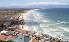 Muizenberg is a beach-side suburb of Cape Town and is situated where the shore of the Cape Peninsula curves round to the east on the False Bay coast. Visit South Africa, Cape Town South Africa, National Geographic Adventure, Adventure Magazine, Table Mountain, Old Building, Most Beautiful Cities, Places Of Interest, Airplane View