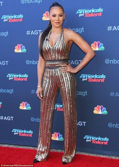 All eyes on me: Mel B ensured her first public appearance since initiating divorce proceedings against husband Stephen Belafonte was a glamorous affair at the official launch of America's Got Talent on Monday evening Mel Brown, Playsuits, Jumpsuits, Spice Girls, Heidi Klum, Female Singers, Celebs, Celebrities, Divorce