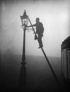A lamplighter in the London fog, Finsbury Park, 1936