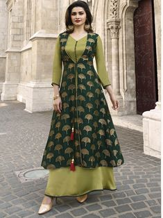 Fashion and trend will be on the peak of your elegance the moment you dresses this TV Actress Prachi Desai Dark Green Color Jacquard Silk Ready Made Kurtis Designs For Dresses, Dress Neck Designs, Blouse Designs, Churidhar Designs, Indian Gowns Dresses, Pakistani Dresses, Indian Designer Outfits, Designer Dresses, Designer Kurtis