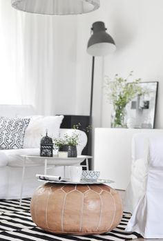 Great idea - using a moroccan leather pouf and a silver tray to add some extra table room! http://www.casablancamarket.com/products/embroidered-leather-pouf-natural-desert-starburst-stitch