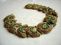 Egyptian spirit.Neclace made in amber silk pieces and green seed beads.