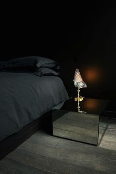 Maison Martin Margiela often uses mirrored surfaces to create illusory effects, as shown here on this night table.