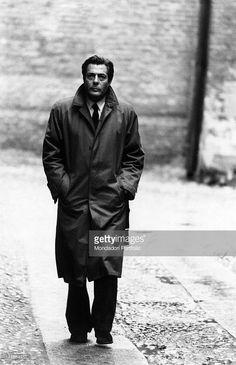 Italian actor Marcello Mastroianni walking along a street. Pavia, 1980