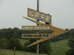 Next to the Lebanon I-44 Speedway, this sign once pointed to a café featuring fried chicken and homemade pie… but no place stands next to it today.