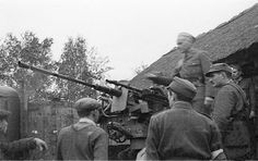 Polish forces inspect captured flak cannon - Huge Collection Of The Warsaw Uprising Photos 18  Best of Web Shrine