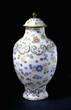 Painted enamel lidded flowerpot--Made in the middle Qing Dynasty for imperial use, the lidded flowerpot is considered a masterpiece for its unique pattern of different flowers painted with more than 20 colors.