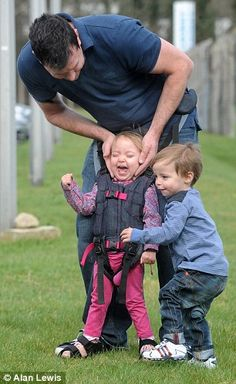 Upsee harness, invention by mum of disabled son helps physically impaired children walk... Heartwarming scene: Charlotte's twin brother Daniel was delighted to see his sister, who has cerebral palsy, walking