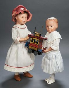 Apples - An Auction of Antique Dolls: 40 American Carved Wooden Brown-Eyed Girl by Schoenhut